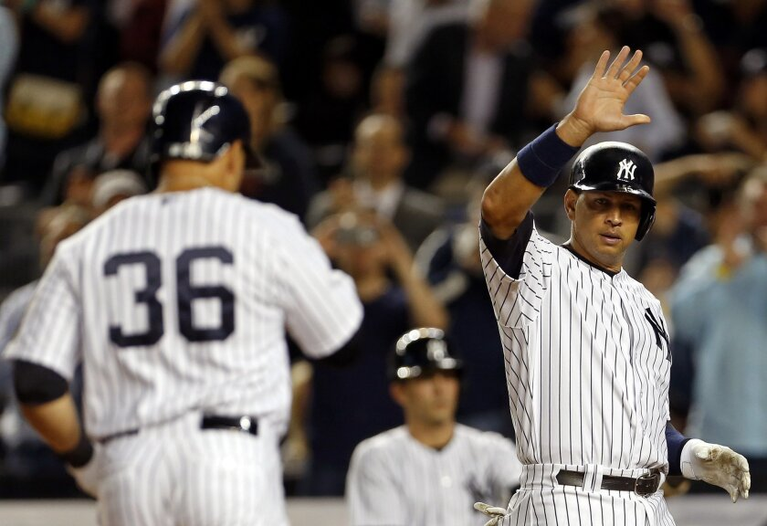 New York Yankees' Alex Rodriguez prepares to high-five Carlos Beltran after Beltran hit a three-run home run during the third inning of a baseball game against the Chicago White Sox on Thursday, Sept. 24, 2015, in New York. (AP Photo/Adam Hunger)