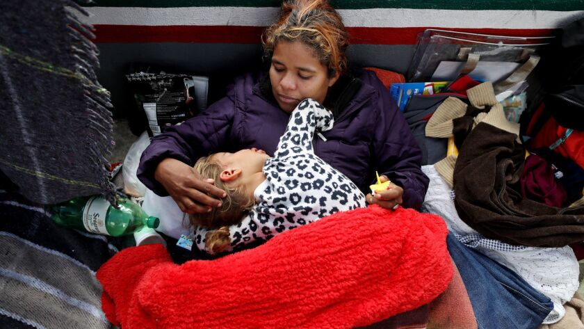 Wendi Garcia of Honduras and her son Oscar, 2, await an appointment for asylum at an encampment near the El Chaparral Port of Entry in Tijuana.