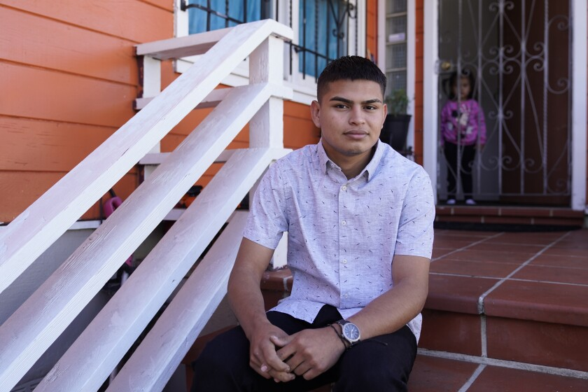 Alan Reyes Picado poses outside his home, as his niece looks on from behind, in San Francisco, California, Friday, July 9, 2021. Reyes arrived in the United States in Feb. 2021, after receiving death threats in Nicaragua and is asking for asylum. (AP Photo/Eric Risberg)