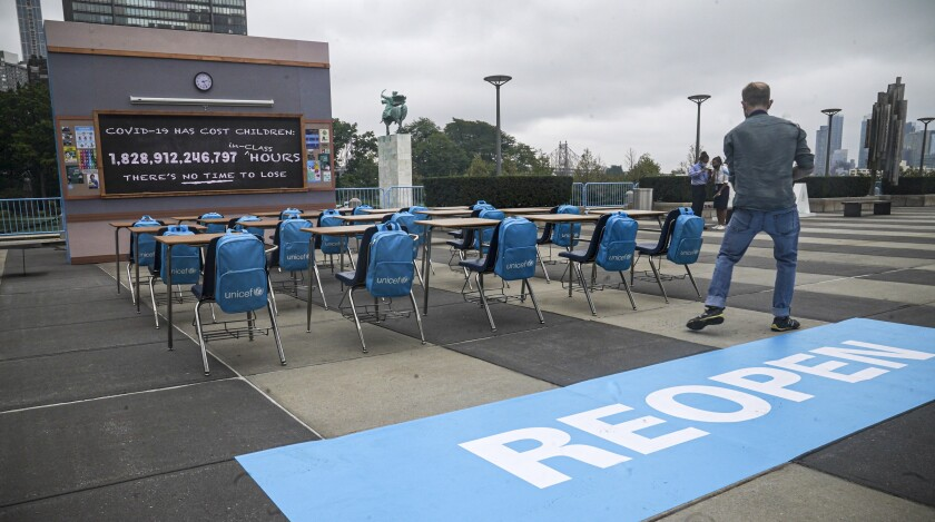 UNICEF unveiled its art installation 'No Time to Lose,' featuring a counting clock on a blackboard of an empty classroom, displaying in real-time the 1.8 trillion hours – and counting – of lost in-person learning around the world since the pandemic's onset, Friday Sept. 17, 2021 at U.N. headquarters. The installation will be on display throughout the course of the 76th session of the United Nations General Assembly (UNGA). (AP Photo/Bebeto Matthews)