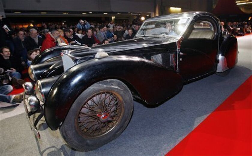 A rare 1937 Bugatti Type 57S Atalante Coupe, originally the property of Francis Curzon, the 5th Earl Howe, is seen displayed at the Retromobile Vintage Cars show, in Paris, Friday, Feb. 6, 2009. The car abandoned in the garage for 50 years has sold at auction for approximately euro3.100,000, US$ 4.006,000, Saturday. (AP Photo/Jacques Brinon)