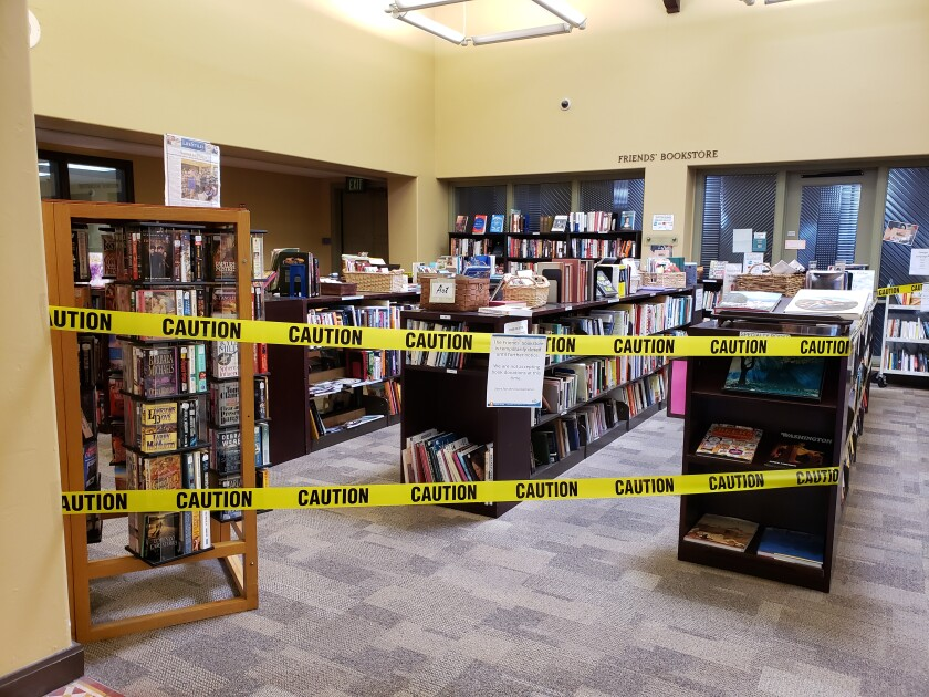 Caution tape was spread across bookshelves at the La Jolla/Riford Library in October to prevent crowding.