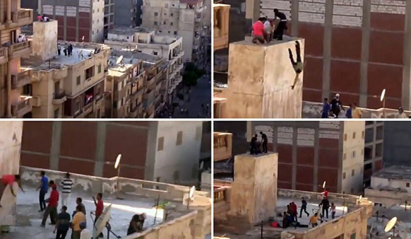 Images from a video uploaded to YouTube on Friday purport to show a group of teenage boys atop a building in Alexandria, Egypt, being surrounded by a group of men and then hurled off the roof.