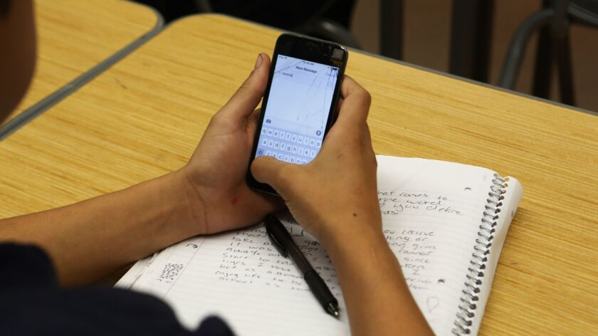 SAN FERNANDO, CA. - NOVEMBER 17, 2015: Cell phones are used to poll answers to questions in teacher
