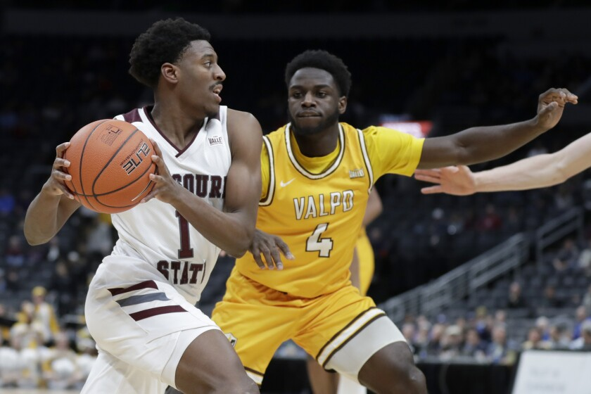Missouri State's Keandre Cook (1) heads to the basket past Valparaiso's Daniel Sackey (4) during the second half of an NCAA college basketball game in the semifinal round of the Missouri Valley Conference men's tournament Saturday, March 7, 2020, in St. Louis. (AP Photo/Jeff Roberson)