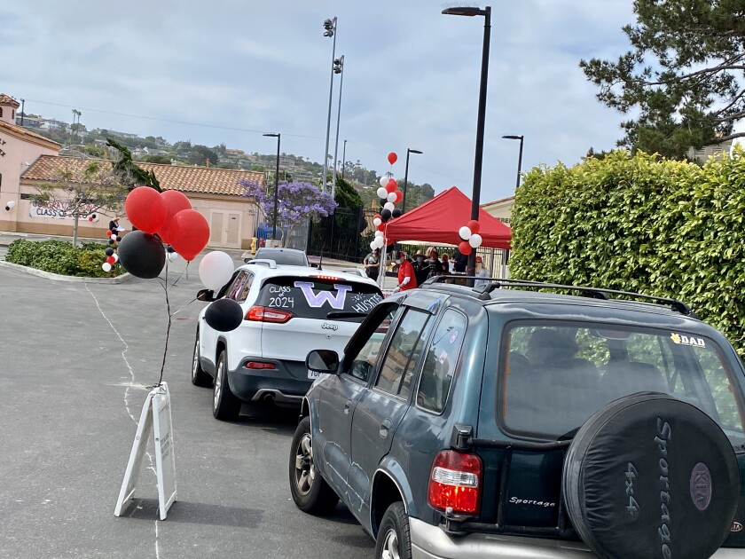 La Jolla High seniors participate in a drive-through celebration June 2 in place of a traditional commencement ceremony.