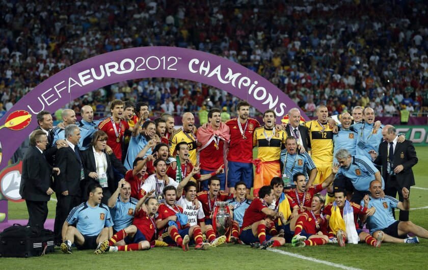 FILE - In this Sunday, July 1, 2012 file photo, the Spanish team poses with the trophy after  the Euro 2012 soccer championship final  between Spain and Italy in Kiev, Ukraine. The European Championship has a reputation for being the soccer fans' favorite tournament on the global calendar. (AP Phot