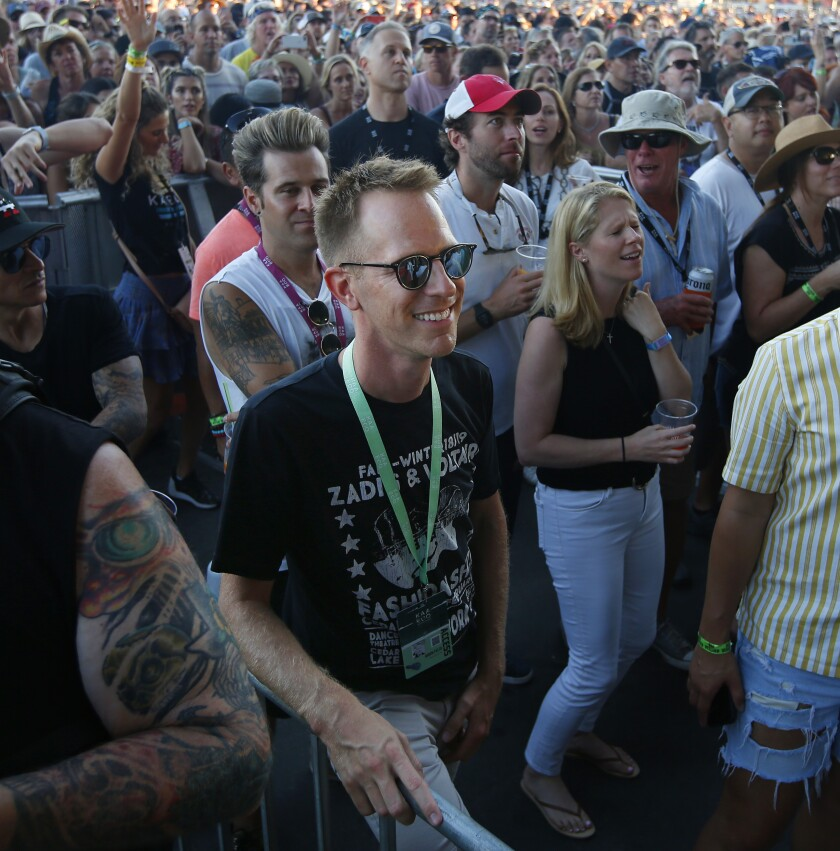KAABOO honcho Jason Felts, at center in sunglasses, watches OneRepublic perform at the Sunset Cliffs stage at KAABOO Del Mar on Saturday, Sept. 14, 2019. The fate of the 2020 KAABOO San Diego festival at Petco Park remains to be determined.