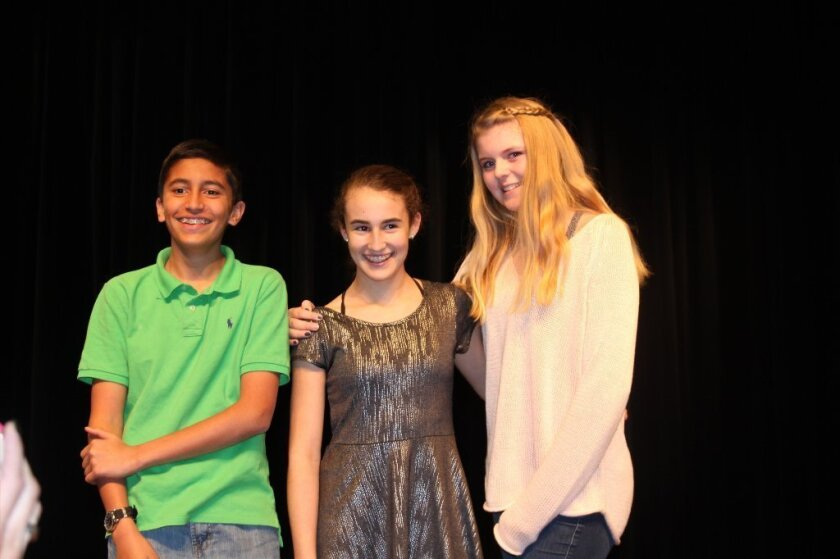 The speech contest winners (L-R) Wasay Zaman (third), Sofia Symon (first), and RiAnna Wright (second). Photo by Karen Billing