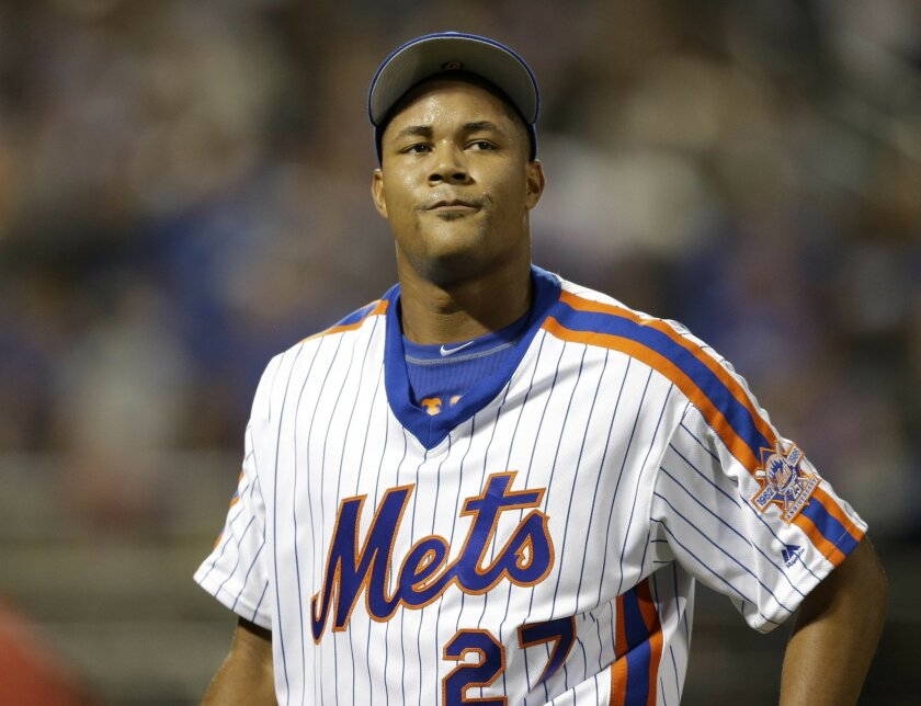 New York Mets relief pitcher Jeurys Familia reacts as he leaves the field during the ninth inning of the baseball game against the Los Angeles Dodgers at Citi Field, Sunday, May 29, 2016 in New York. The Dodgers won 4-2. (AP Photo/Seth Wenig)