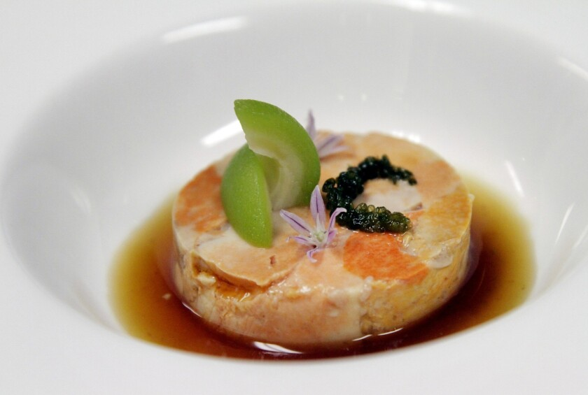 Ankimo (monkfish liver) is combined with umeboshi ponzu, sea grapes and momokochan.