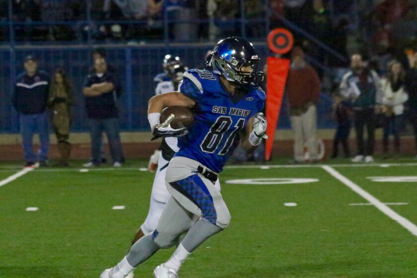 San Marino wide receiver J.P. Shohfi runs after making a catch against Summit in the South Section playoffs.
