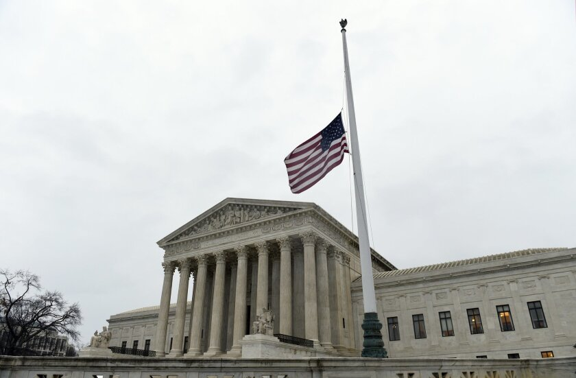 The flag flies at half-staff outside the Supreme Court in Washington, Tuesday, Feb. 16, 2016, following the death of Supreme Court Justice Antonin Scalia over the weekend.  (AP Photo/Susan Walsh)