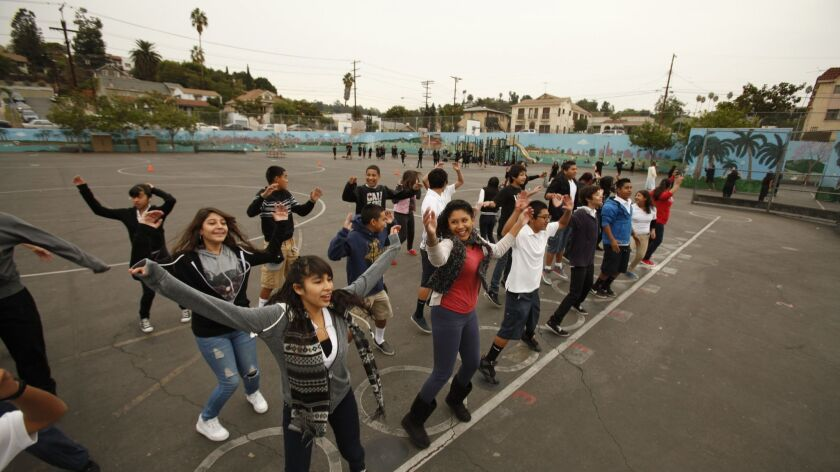 LOS ANGELES, CA - NOVEMBER 15, 2012: Eight grade physical education students from Logan Street Elem