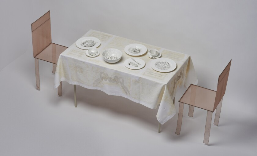 """""""Dinner for two in a smoggy month, 2011"""" consists of white porcelain tableware and linens colored by air pollution."""