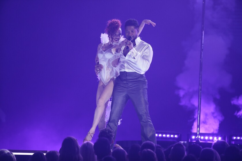 FKA twigs and Usher perform a Prince tribute at the 62nd Grammy Awards.