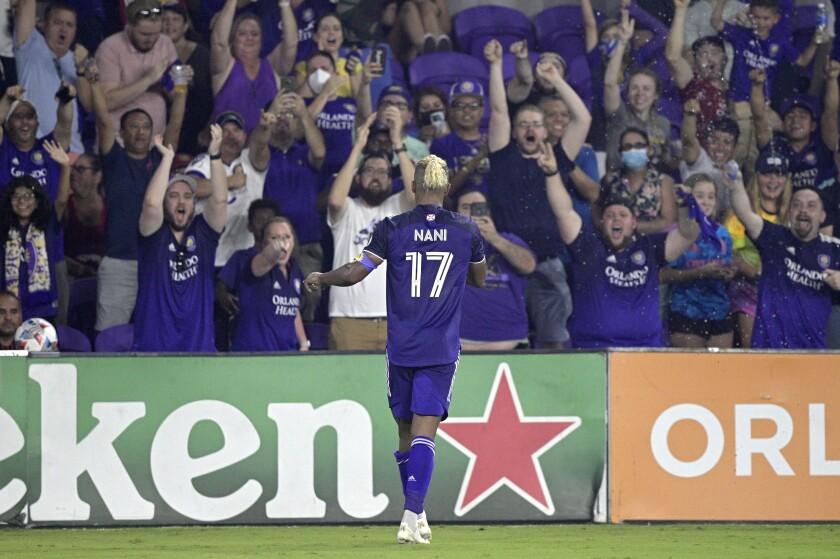 Orlando City forward Nani (17) celebrates with fans after scoring a goal during the second half of an MLS soccer match against Atlanta United, Friday, July 30, 2021, in Orlando, Fla. (Phelan M. Ebenhack/Orlando Sentinel via AP)