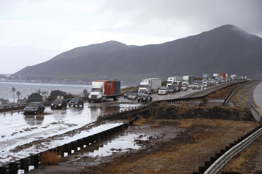 Southbound traffic on the 101 Freeway in Ventura County crawls through one lane Tuesday after mud flowed over the freeway.