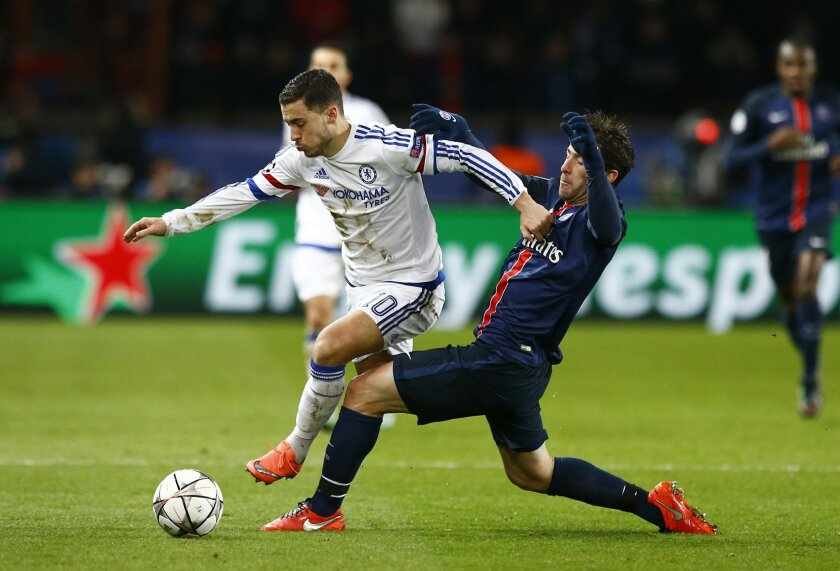 Chelsea's Eden Hazard, left gest past the tackle of PSG's Lucas during the Champions League round of 16, first leg, soccer match between Paris Saint Germain and Chelsea at the Parc des Princes  stadium, in Paris, Tuesday, Feb. 16, 2016. (AP Photo/Francois Mori)