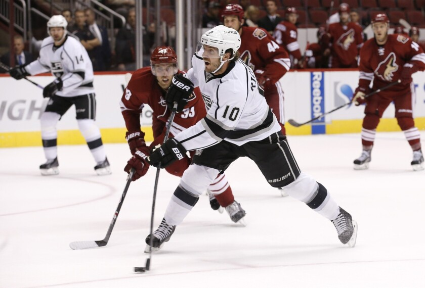 Mike Richards scores against the Arizona Coyotes during the first period of an exhibition game on Monday at Jobing.com Arena in Glendale, Ariz.