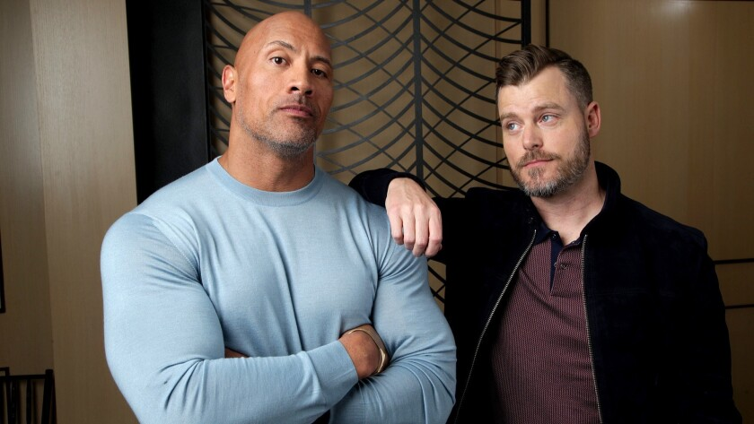"""Star Dwayne Johnson, left, and writer-director Rawson Marshall Thurber of """"Skyscraper,"""" the only major studio release in July that is not part of an existing franchise."""