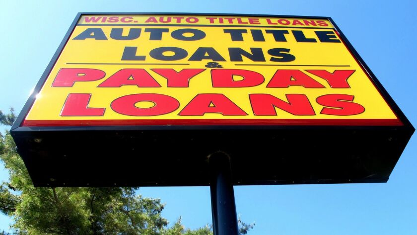 In this May 19, 2010 file photo a sign for a Wisconsin Auto Title Loans store is seen in Madi