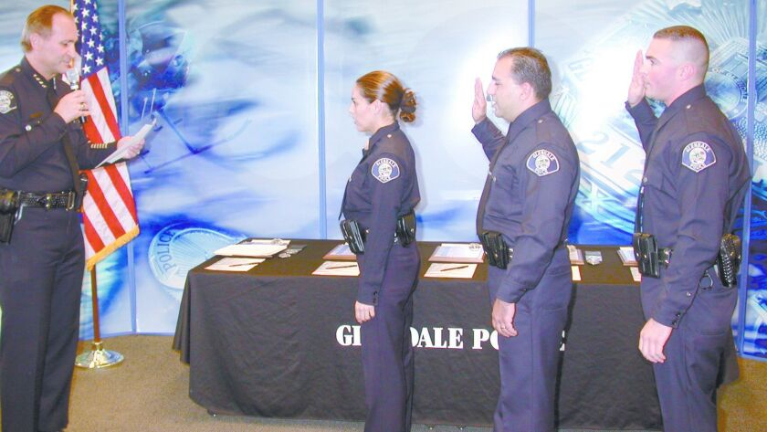 Former Chief Randy Adams, left, swears in lateral transfers, including John Balian in the center, in 2004.
