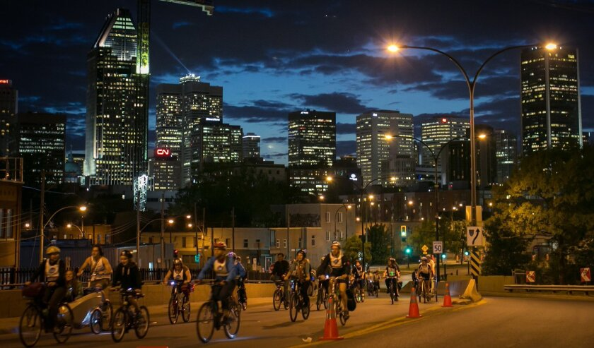 This undated image provided by Velo Quebec shows bicyclists touring Montreal, Canada, as part of a bike festival that typically brings out 15,000 people for a night ride and 25,000 for the main event a few days later. This year's Tour la Nuit is June 3 and the Tour de l'lle rolls Sunday, June 5. (Didier Bertrand, Velo Quebec, via AP)