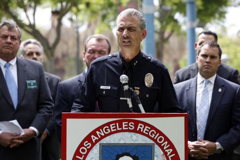 """LAPD Deputy Chief Kirk Albanese and other authorities hold a press conference at Jesse A. Brewer Jr. Park to announce the results of """"Operation Broken Heart,"""" which resulted in the arrest of more than 275 """"child predators,"""" according to a press release."""