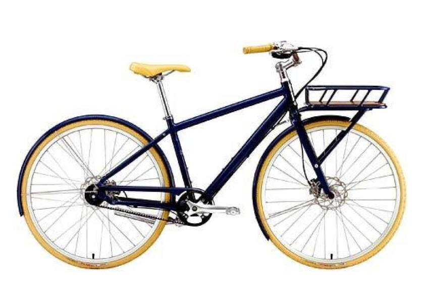 """<b>Shop till you drop:</b> Deluxe eight-speed, aluminum-frame """"shopping bike"""" with a large front rack, wraparound handlebars, disc brakes, bell, kickstand and fenders from Specialized's new Globe division."""