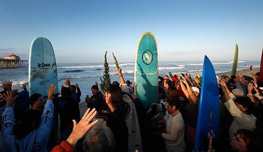"The faithful join a variety of spiritual leaders at the Huntington Beach Pier for a ""blessing of the waves"" service sponsored by the Roman Catholic Diocese of Orange. Amid sunny skies and a building ocean swell of 6- to 10-foot waves, the worshipers prayed for tubular surf and a safe return to shore. More photos >>>"