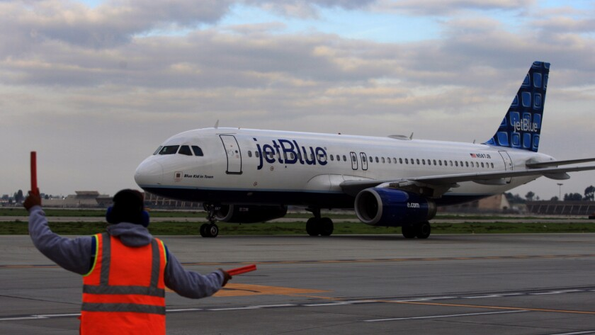 A Jet Blue flight taxis at the Long Beach Airport in 2012. The airline has asked the city of Long Beach to look into allowing international flights.