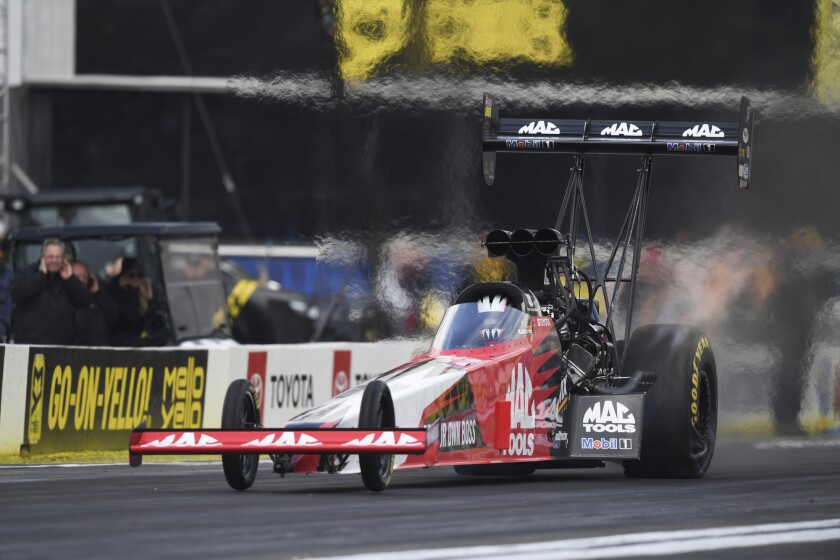 Doug Kalitta competes in the final round at the NHRA Winternationals at Auto Club Raceway in Pomona on Sunday.