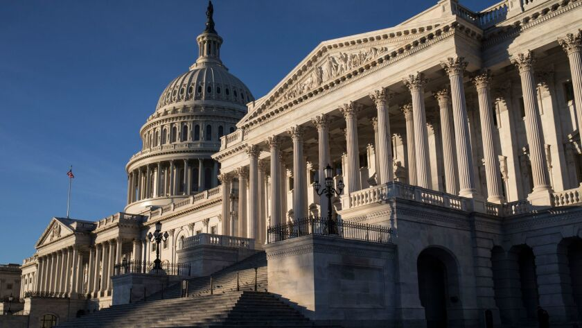 Lawmakers were at work at the Capitol on Saturday on the first day of a government shutdown after a divided Senate rejected a funding measure.