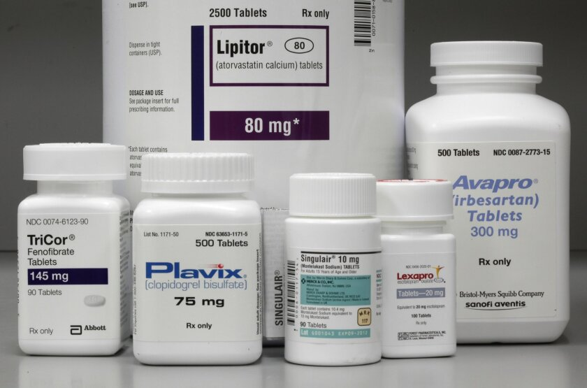 In this June 14, 2011, file photo, bottles of prescription drugs: Lipitor, TriCor, Plavix, Singulair, Lexapro and Avapro are displayed at Medco Health Solutions Inc., in Willingboro, N.J. The pharmaceutical  industry says some reforms could stall development of new medicines.