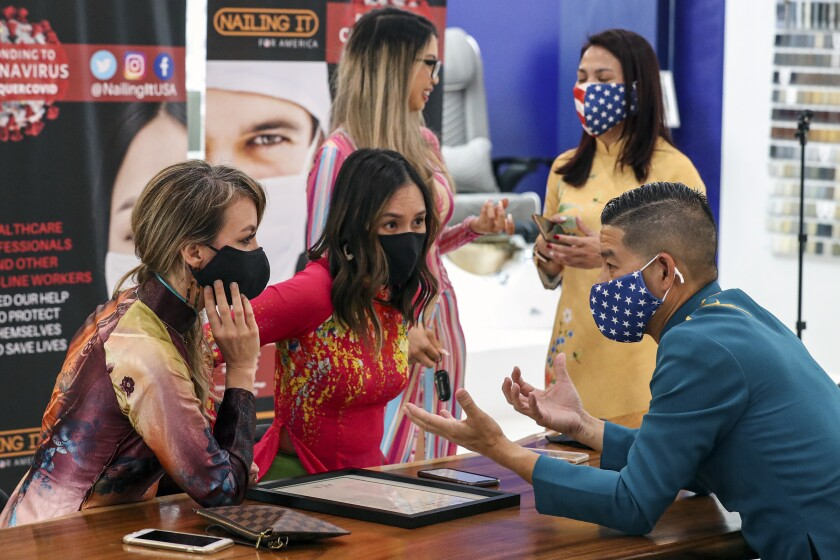 Organizers of Nail It for America strategize on reopening nail salons at Whale Spa Salon Furniture in Huntington Beach.