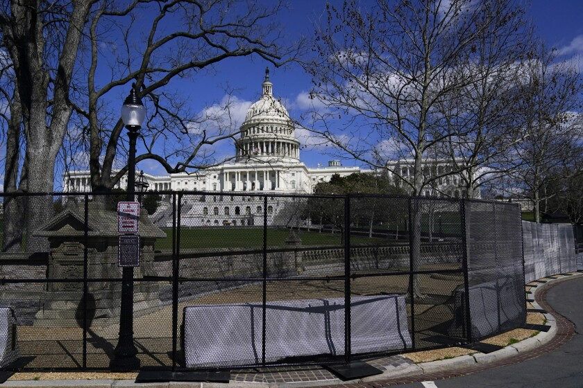 FILE - In this April 2, 2021, file photo the U.S. Capitol is seen behind security fencing on Capitol Hill in Washington. The fencing installed around the Capitol after the deadly Jan. 6 insurrection will start being removed as soon as Friday, July 9, but most visitors are still not allowed inside the iconic building. (AP Photo/Carolyn Kaster, File)
