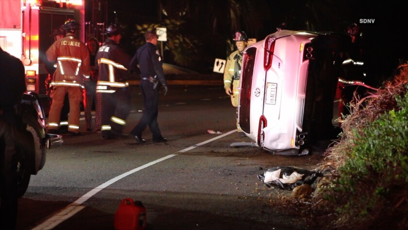 A woman who had ran out of gas was hurt when she was struck by a sedan that came to rest on its side around 2:30 a.m. on the transition ramp from southbound I-5 to westbound SR-76.
