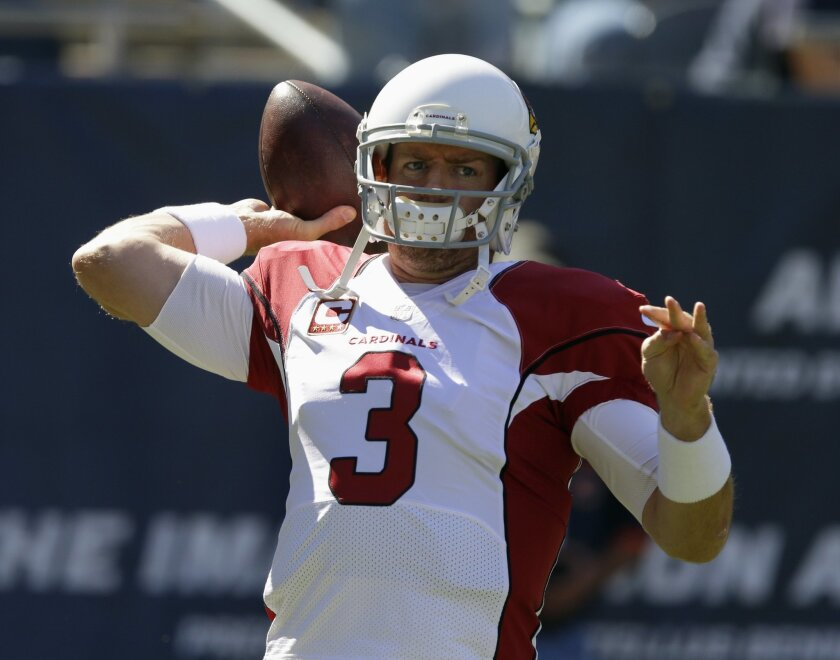 Arizona Cardinals quarterback Carson Palmer (3) warms up before an NFL football game against the Chicago Bears, Sunday, Sept. 20, 2015, in Chicago. (AP Photo/Michael Conroy)