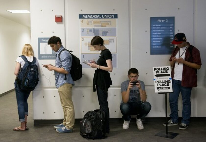 UC Davis students line up to cast ballots in November 2012 election. Changes in California's 102-year-old initiative process may one day be put to voters.