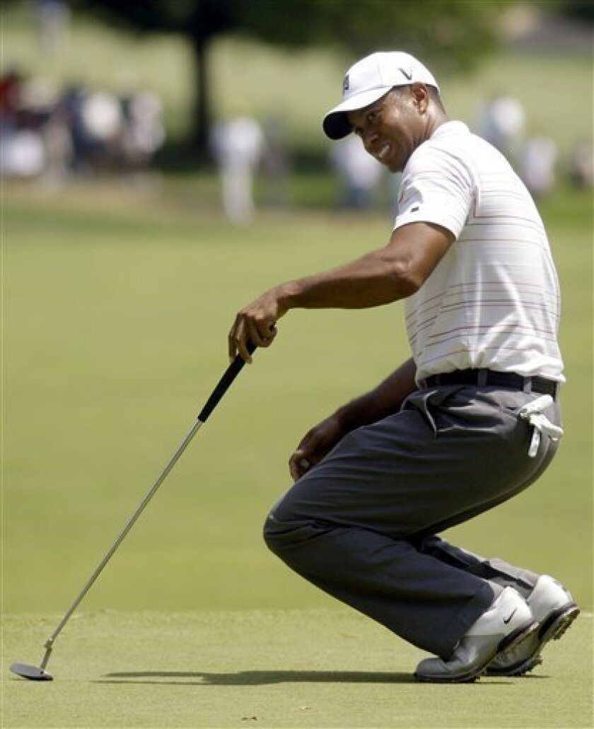 Tiger Woods reacts to a missed putt on the fourth green during the third round of the AT&T National golf tournament at Congressional Country Club, Saturday, July 4, 2009, in Bethesda, Md. (AP Photo/Haraz N. Ghanbari)