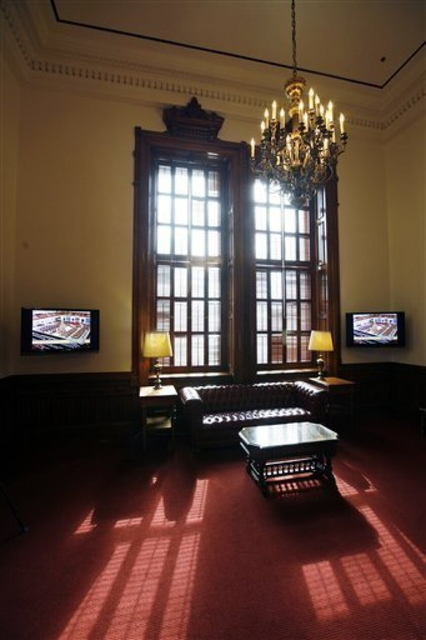 Light streams in from a window in the newly remodeled Texas House of Representatives Lounge in the Texas State Capitol , Monday, Dec. 8, 2008, Austin, Texas. Additions include new carpet, new television monitors, new chandeliers, new paint, new cabinets and countertops. (AP Photo/Erich Schlegel)