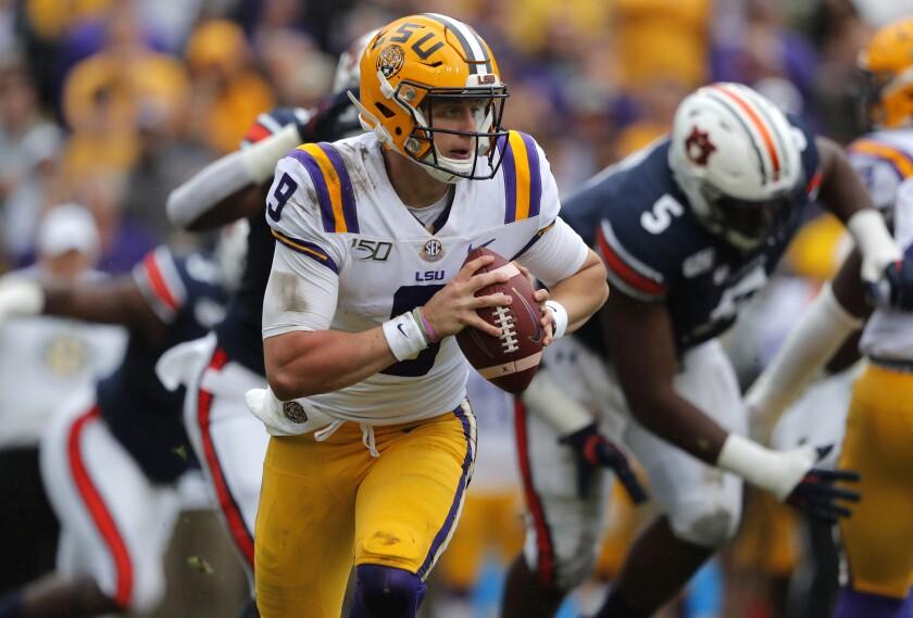 LSU quarterback Joe Burrow scrambles from Auburn pressure during the first half of their game Oct. 26, 2019, in Baton Rouge, La.
