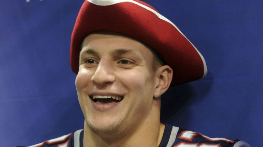 New England Patriots tight end Rob Gronkowski answers a question during the team's Super Bowl media day.