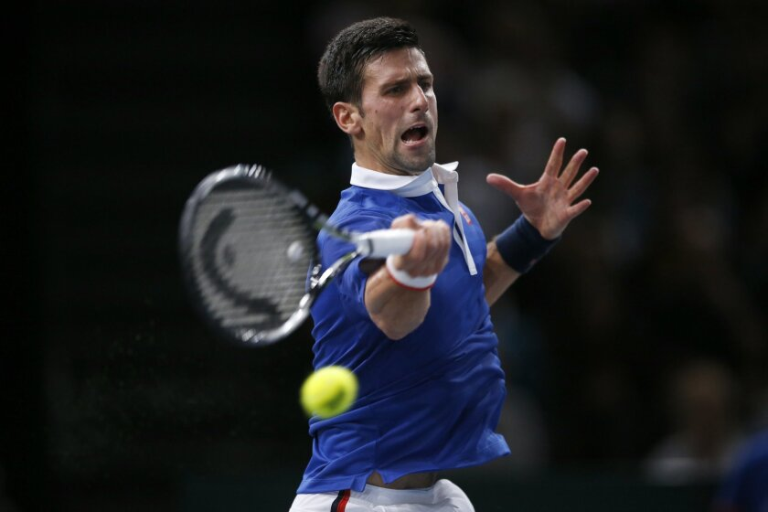Novak Djokovic of Serbia returns the ball to Tomas Berdych of Czech Republic during their quarterfinal match of the BNP Masters tennis tournament, at Bercy Arena, in Paris, France, Friday, Nov. 6, 2015. (AP Photo/Francois Mori)