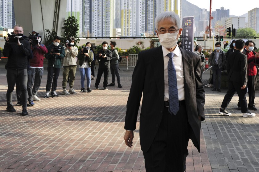 """Pro-democracy lawmaker Martin Lee arrives at a court in Hong Kong Tuesday, Feb. 16, 2021. Nine prominent Hong Kong's democracy advocates faced trial Tuesday on charges of organizing an unauthorized assembly in August 2019. Among the defendants veteran octogenarian lawyer and dubbed Hong Kong's """"father of democracy"""" Lee and media tycoon Jimmy Lai. (AP Photo/Vincent Yu)"""