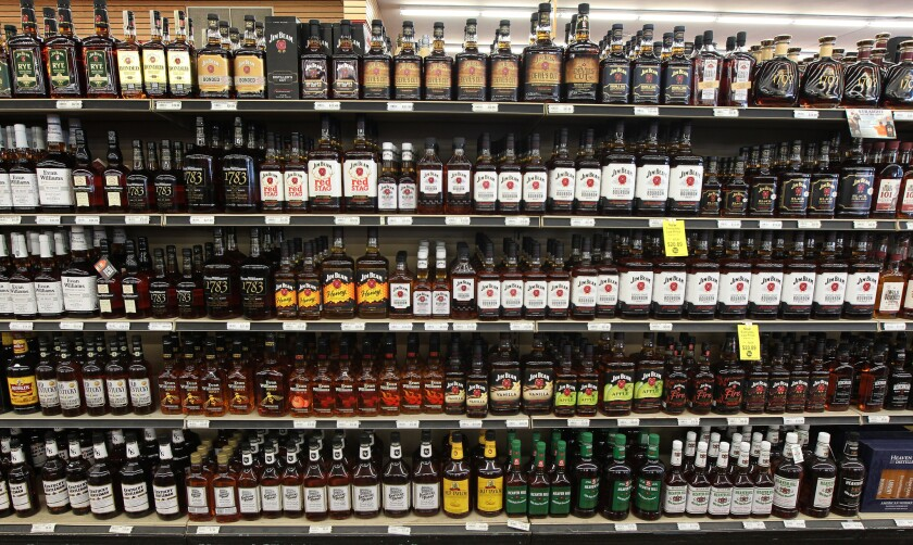 Bourbon is seen at a Party Mart liquor store on June 1, 2018, in Louisville, Ky. The U.S. government is shutting down a study that was supposed to show if a single drink a day could prevent heart attacks, saying ethical problems with how the research was planned and funded undermine its credibility.