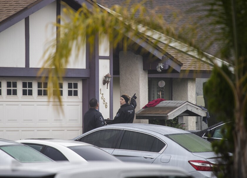 Ontario police investigate the scene where two children and a county probation officer were killed in a shooting at an Ontario home Saturday morning.