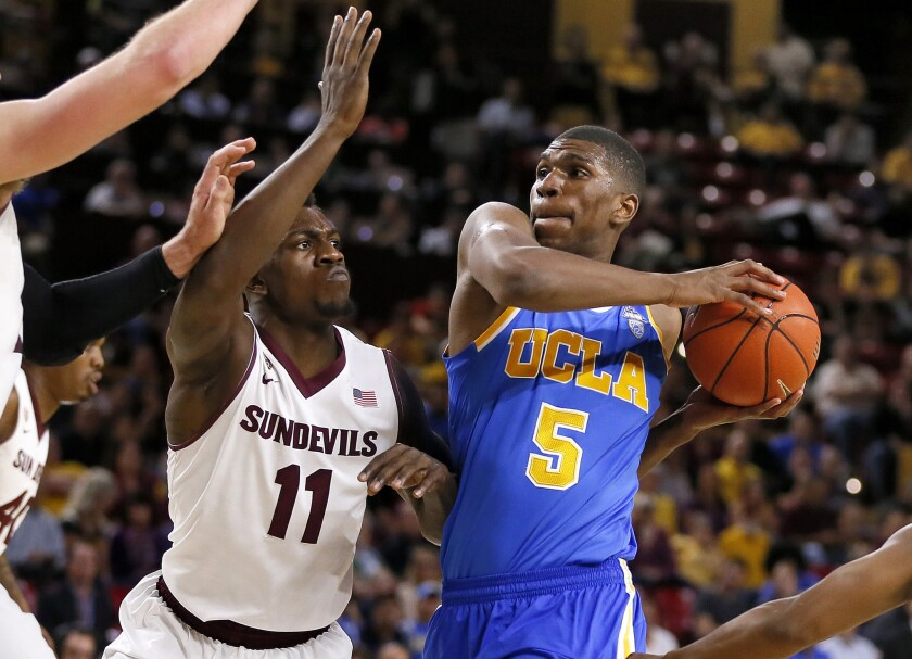 UCLA forward Kevon Looney (5) drives to the basket against Arizona State's Savon Goodman during the first half of a game on Feb. 18.