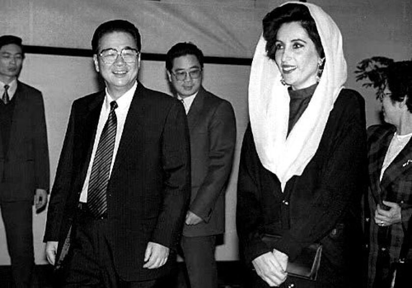 Chinese Premier Li Peng and his Pakistani counterpart, Benazir Bhutto, head to a meeting room at the Great Hall of the People in Beijing after an official welcoming ceremony in 1993.